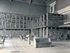 Undated photo ca.1903-1909 of the Connecticut State Library when it was located in the State Capitol. View is facing east and shows the all-metal tiered shelving installed in 1903, and the new electric lights