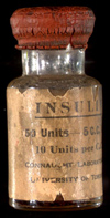 Bottle of insulin with beige label printed in black with red rubber stopper, Connaught Medical Research Laboratories, Toronto, November 5, 1923